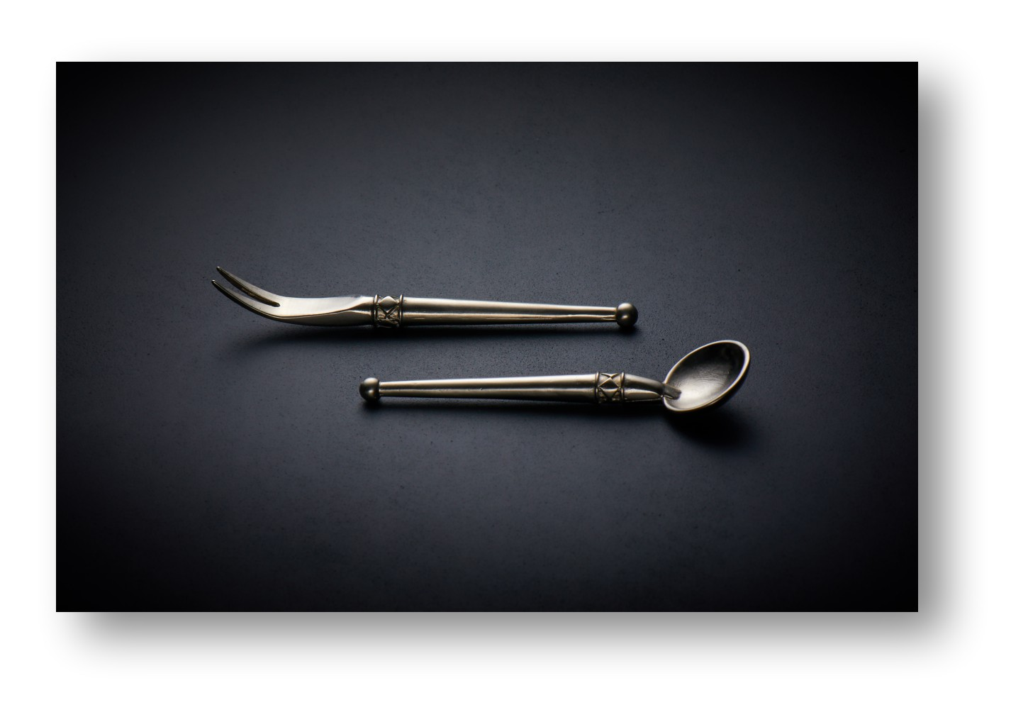 Antique Spoon and Fork with soft light graduated background